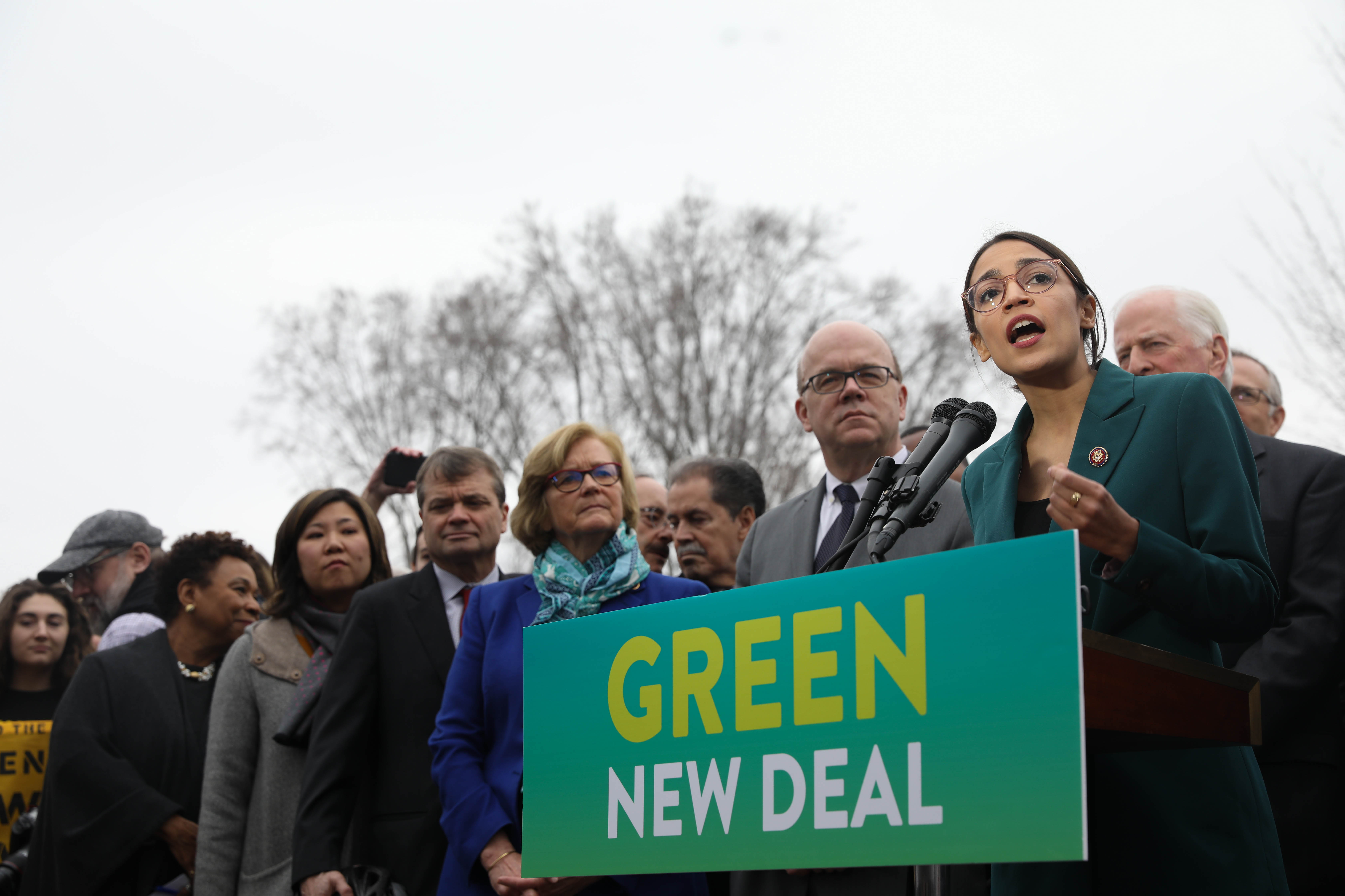 Representative Alexandria Ocasio-Cortez speaks on the Green New Deal with Senator Ed Markey (right) in front of the Capitol Building in February 2019. Credit: Senate Democrats, CC BY 2.0