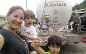 After two days on rotation with their neighbors sitting on the main street watching for the gas delivery truck, this was the family's look of joy when it arrived for the first time since the hurricane. They were down to 3%.